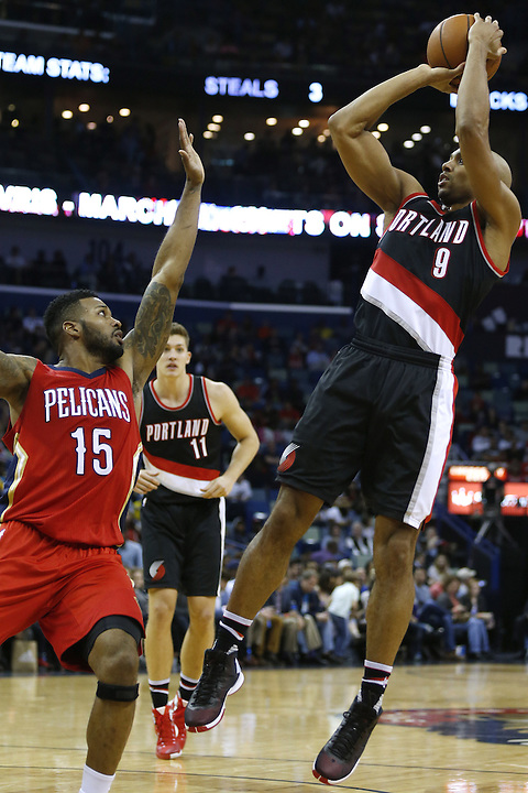 Portland Trail Blazers guard Gerald Henderson (9) shoots the ball over New Orleans Pelicans forward Alonzo Gee (15) during the first half of an NBA basketball game Wednesday, Dec. 23, 2015, in New Orleans. The Pelicans won 115-89. (AP Photo/Jonathan Bachman)