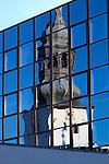 Denmark, Jutland, Aalborg: Tower of Budolfi Domkirke, 12th century cathedral, reflected in office window | Daenemark, Juetland, Aalborg: Reflektion der Budolfi Domkirke in Glasfront eines modernes Buerogebaeudes