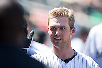 Matt Davidson (22) of the Charlotte Knights high fives teammates after hitting a home run against the Indianapolis Indians at BB&T BallPark on June 21, 2015 in Charlotte, North Carolina.  The Knights defeated the Indians 13-1.  (Brian Westerholt/Four Seam Images)