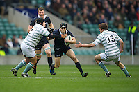 Jonathan Hudson of Oxford University  is tackled by Stuart Brown (left) and Danny Holmes of Cambridge University during the 131st Varsity Match between Oxford University and Cambridge University at Twickenham on Thursday 06 December 2012 (Photo by Rob Munro)