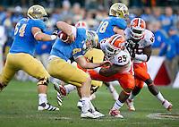 SAN FRANCISCO, CA - December 31, 2011: Illinois linebacker Ashante Williams (25) attempts to bring down UCLA quarterback Kevin Prince (4) against University of Illinois at AT&T Park in San Francisco, California. Final score Illinois wins 20-14.