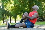 Mature man exercising, side view