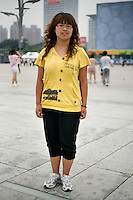 Jiexuan, a teacher, age 27, poses for a portrait in Beijing. Response to 'What does China mean to you?': 'Home.'  Response to 'What is your role in China's future?': 'To be a creator.'