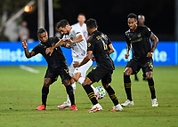 LAKE BUENA VISTA, FL - JULY 18: Sebastian Lletget #17 of LA Galaxy loses possession while defended by Diego Palacios #12 of LAFC, Eddie Segura #4 of LAFC and Mark-Anthony Kaye #14 of LAFC during a game between Los Angeles Galaxy and Los Angeles FC at ESPN Wide World of Sports on July 18, 2020 in Lake Buena Vista, Florida.