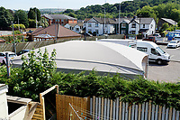 Pictured: The top of the car wash as seen from the top window of the house owned by Anne Parker in Pontypridd, Wales, UK. Monday 02 July 2018<br /> Re: Pensioner Anne Parker says the peace and quiet of her garden has been shattered after a car wash was installed by rental firm Enterprise on the other side of her back fence in Pontypridd, Wales, UK.