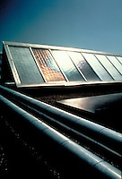 Close up of solar collector panels and pipes, energy, solar power, heat, passive solar. RB0534075. In En El So.