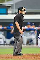 Home plate umpire Garon Keuten during the Appalachian League game between the Elizabethton Twins and the Burlington Royals at Burlington Athletic Park on June 25, 2014 in Burlington, North Carolina.  The Twins defeated the Royals 8-0. (Brian Westerholt/Four Seam Images)