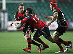 Inside centre Denis Hurley of Munster Rugby tackles Inside centre Ashley Smith of Newport Gwent Dragons.<br /> <br /> Guiness Pro 12<br /> Newport Gwent Dragons v Munster Rugby<br /> Rodney Parade<br /> 21.11.14<br /> ©Steve Pope-SPORTINGWALES