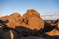 Bouldering shadows on Capo Testa beach, Sardinia, Italy