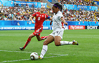 USA's Sydney Leroux (C) scores 4:0 against Danique Stein (Switzerland) during the FIFA U20 Women's World Cup at the Rudolf Harbig Stadium in Dresden, Germany on July 17th, 2010.