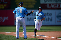 Erie SeaWolves manager Mike Rabelo (58) congratulates Kody Eaves (22) after hitting a home run during an Eastern League game against the Akron RubberDucks on June 2, 2019 at UPMC Park in Erie, Pennsylvania.  Erie defeated Akron 8-5 in eleven innings in the second game of a doubleheader.  (Mike Janes/Four Seam Images)