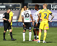 17th April 2021; Liberty Stadium, Swansea, Glamorgan, Wales; English Football League Championship Football, Swansea City versus Wycombe Wanderers; Andre Ayew of Swansea City signals an injury to his left leg to Referee Keith Stroud early in the first half in which he is substituted for