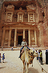 Camel and tourists in front of the Kaznah. Middle East. Jordan. Petra