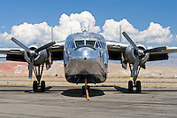 """C-119 Flying Boxcar (N15501) was manufactured by Fairchild Aircraft Company in 1968 and was formerly owned by Hawkins & Powers of Greybull, Wyoming. Hawkins and Power's, once renowned for their aerial firefighting aircraft, flew N15501 to Africa to film the opening sequences of the 2004 remake of the film Flight of the Phoenix. Three other ex USMC C-119Fs were used in various wreck scenes. <br /> The Air Force C-119 Flying Boxcar (Navy R4-Q) was initially a redesign of the Fairchild C-82 Packet that was built between 1945 and 1948. The C-119 addressed many of the shortcomings of the Packet with more usable cargo space, more powerful engines, and a stronger airframe. The first C-119 was delivered in December of 1949 and saw extensive action in the Korean War as a troop and equipment transport. Later versions would be modified for satellite tracking or as a """"Stinger"""" gunship. and A total of 1185 C-119's were built and were in service with the Air Force until 1973. Civilian-operated C-119s were used as firebombers and transports in the northwest United States."""