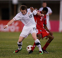 Jack McBean (19) of the United States fights for the ball with Alfredo Stephens (19) of Panama during the group stage of the CONCACAF Men's Under 17 Championship at Jarrett Park in Montego Bay, Jamaica. The USA defeated Panama, 1-0.
