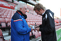 Graham Potter Manager of Swansea City signs the match day program for a Stoke City fan prior to the Sky Bet Championship match between Stoke City and Swansea City at the Bet 365 Stadium in Stoke on Trent, England, UK. Tuesday 18 September 2018