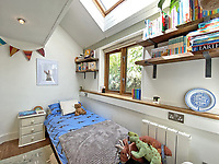 BNPS.co.uk (01202) 558833. <br /> Pic: LillicrapChilcott/BNPS<br /> <br /> Pictured: Bedroom. <br /> <br /> A pretty wooden cottage with spectacular panoramic sea views is on the market for £595,000.<br /> <br /> The aptly-named The Hut is an eco-built property set on a hill in the hugely sought-after Cornish village of Mousehole.<br /> <br /> The small but perfectly-formed home looks down over Mousehole harbour and across Mounts Bay to St Michael's Mount.