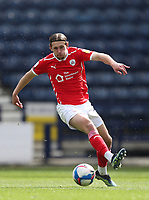 1st May 2021; Deepdale Stadium, Preston, Lancashire, England; English Football League Championship Football, Preston North End versus Barnsley; Callum Brittain of Barnsley plays a pass with the outside of his boot