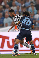 Calcio, Supercoppa di Lega: Juventus vs Lazio. Roma, stadio Olimpico, 18 agosto 2013.<br /> Juventus forward Mirko Vucinic, of Montenegro, is challenged by Lazio defender Giuseppe Biava, right, during the Italian League Supercup football final match between Juventus and Lazio, at Rome's Olympic stadium,  18 August 2013.<br /> UPDATE IMAGES PRESS/Isabella Bonotto