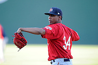 Pitcher Raynel Velette (34) of the Greenville Drive works on a pitcher fielding drill on the team's Media Day first workout on Tuesday, April 1, 2014, at Fluor Field at the West End in Greenville, South Carolina. (Tom Priddy/Four Seam Images)