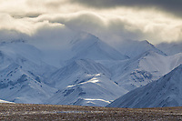 Clouds form over the Endicott mountains and the snowy tundra of Alaska's Arctic