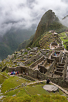 Peru, Machu Picchu.  Looking Down on the Western Urban Sector, Uña Picchu behind the Intiwatana (Hitching Post of the Sun).