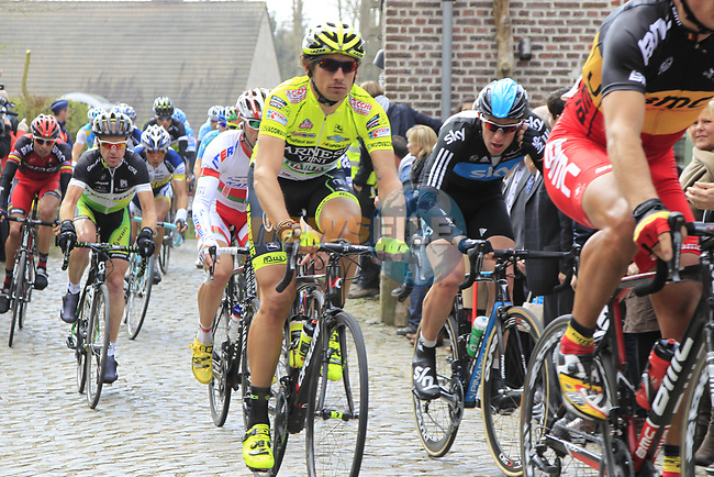 The peloton including Filippo Pozzato (ITA) Farnese Vini-Selle Italia climb Molenberg during the 96th edition of The Tour of Flanders 2012, running 256.9km from Bruges to Oudenaarde, Belgium. 1st April 2012. <br /> (Photo by Eoin Clarke/NEWSFILE).
