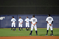 Tampa Yankees players Ali Castillo #12, Anderson Feliz #20 along with Mason Williams #14, Ben Gamel #6, and Eduardo Sosa #17 stand for the national anthem before a game against the Lakeland Flying Tigers at Steinbrenner Field on April 6, 2013 in Tampa, Florida.  Lakeland defeated Tampa 8-3.  (Mike Janes/Four Seam Images)