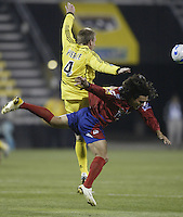 08 November 2006: CSD Municipal's Mario Rodriguez, right, and Columbus Crew's Rusty Pierce collide during the first half Wednesday, Nov. 8, 2006, in Columbus, Ohio.<br />