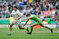 Mat Turner of England accelerates past Con Foley of Australia during the iRB Marriott London Sevens at Twickenham on Sunday 13th May 2012 (Photo by Rob Munro)