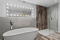 BNPS.co.uk (01202) 558833. <br /> Pic: ScottParry/BNPS<br /> <br /> Pictured: Bathroom. <br /> <br /> Life's a beach...<br /> <br /> A coastal clifftop home above a picturesque Cornish beach is on the market for £1.75m.<br /> <br /> High Seas sits in a prime position above Millendreath Beach in Looe, the 'Cornish Riviera', with spectacular views across Whitsand Bay and out to sea.<br /> <br /> The impressive five-bedroom property has almost 5,000 sq ft of living space and a decent sized garden, but it's real draw is its location.<br /> <br /> The house is 150 yards from Millendreath Beach and its garden gate will take the owners straight onto the South West Coast Path.