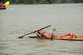 A Matis competitor lies back in relief after his heat in the canoeing event at the International Indigenous Games, in the city of Palmas, Tocantins State, Brazil. Photo © Sue Cunningham, pictures@scphotographic.com 30th October 2015