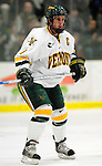 """5 January 2007: University of Vermont forward and co-captain Torrey Mitchell (9) from Greenfield Park, QC, in action against the University of New Hampshire Wildcats at Gutterson Fieldhouse in Burlington, Vermont. The UNH Wildcats defeated the UVM Catamounts 7-1 in front of a record setting 48th consecutive sellout at """"the Gut""""...Mandatory Photo Credit: Ed Wolfstein Photo.<br />"""