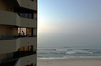 A family in a hotel room prepares themselves for a day at the beach in Virginia Beach, Va.