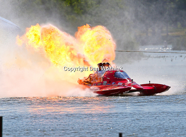 Bryan Sanders (318), driver of the top fuel hydro drag boat,Tequila Sunrise, explodes his engine during the final race Sunday afternoon at Lake Nasworthy in the Showdown in San Angelo drag boat races  in San Angelo,Texas.