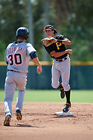Pittsburgh Pirates shortstop Cole Tucker (3) throws to first base to try to complete a double play as Ulrich Bojarski (30) runs to second base during a Florida Instructional League game against the Detroit Tigers on October 2, 2018 at the Pirate City in Bradenton, Florida.  (Mike Janes/Four Seam Images)