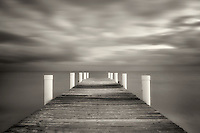 Pier at sunrise in Grace Bay. Providenciales. Turks and Caicos.