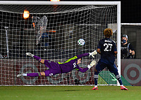 LAKE BUENA VISTA, FL - JULY 26: Gianluca Busio of Sporting KC watches his shootout shot beat Thomas Hasal of Vancouver Whitecaps FC to clinch victory during a game between Vancouver Whitecaps and Sporting Kansas City at ESPN Wide World of Sports on July 26, 2020 in Lake Buena Vista, Florida.
