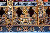 Punakha, Bhutan.  Dragon Woodcarving in the Punakha Dzong (Fortress/Monastery).