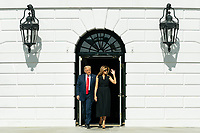 President Trump and First Lady Melania Trump Depart for Tennessee<br /> <br /> President Donald J. Trump and First Lady Melania Trump depart the South Portico entrance of the White House Thursday, Oct. 22, 2020, before boarding Marine One on the South Lawn to begin their trip to Nashville, Tenn. (Official White House Photo by Andrea Hanks)