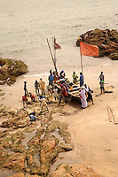 Fisherman land their piogues with the day's catch at Cape Coast Castle, Ghana. .Photograph by Peter E. Randall