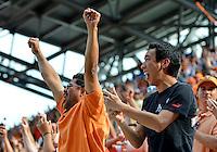 April 28, 2013: Houston Dynamo fans celebrate game tying goal scored by Houston Dynamo mid fielder Giles Barnes #23 during half of Major League Soccer match in Houston, TX. Houston Dynamo draw 1-1 against Colorado Rapids.