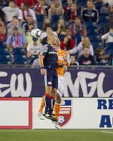 New England Revolution forward Ilica Stojica (9) and Houston Dynamo defender Bobby Boswell (32) battle for head ball. The New England Revolution defeated Houston Dynamo, 1-0, at Gillette Stadium on August 14, 2010.