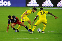WASHINGTON, DC - OCTOBER 28: Edison Flores #10 of D.C. United battles for the ball with Youness Mokhtar #34 of Columbus Crew SC and Fatai Alashe #26 of Columbus Crew SC during a game between Columbus Crew and D.C. United at Audi Field on October 28, 2020 in Washington, DC.