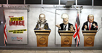 Caricature of Dominic Cummings, Prime Minister Boris Johnson and US President Donald Trump on large advertisement board for satirical television puppet show Spitting Image inside Westminster Tube Station. London September 30th 2020<br /> <br /> Photo by Keith Mayhew