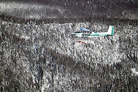 Saturday March 10, 2012  An airplane flies alongside Danny Davidson's (Davidson Aviation) airplane, traveling from Ruby to the Galena checkpoint. Iditarod 2012.