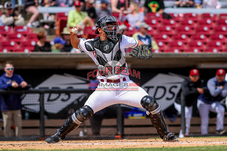Wisconsin Timber Rattlers catcher Brent Diaz (18) throws down to second base between innings of a Midwest League game against the Clinton LumberKings on April 26, 2018 at Fox Cities Stadium in Appleton, Wisconsin. Clinton defeated Wisconsin 7-3. (Brad Krause/Four Seam Images)