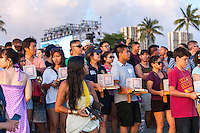 Participants holding lanterns at the 15th annual Lantern Floating Ceremony at Ala Moana Beach Park in Honolulu on Memorial Day On Memorial Day, participants hold lanterns at the 15th Annual Lantern Floating Ceremony at Ala Moana Beach Park, Honolulu, O'ahu.
