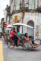 George Town, Penang, Malaysia. Mother and Daughter Riding in a Trishaw.