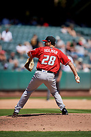 David Holman (28) of the Albuquerque Isotopes delivers a pitch to the plate against the Salt Lake Bees  at Smith's Ballpark on April 22, 2018 in Salt Lake City, Utah. The Bees defeated the Isotopes 11-9. (Stephen Smith/Four Seam Images)